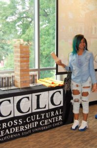 A girl standing next to CCLC table