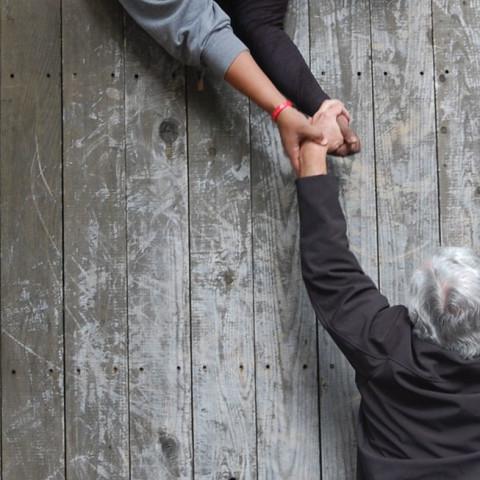 Bernie-cloe-up-hands-scaling-wall