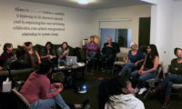 Image of community members gathered for SYA event.